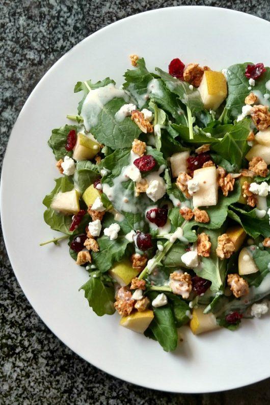 Kale salad with granola and and a tangy yogurt vinaigrette // evolvingmotherhood.com